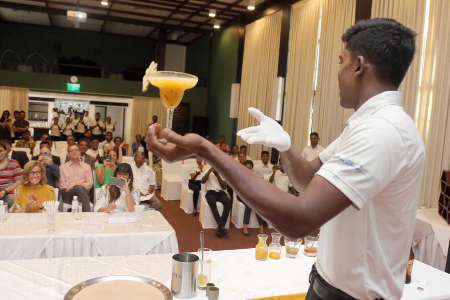 TCF_Sri_Lanka_student presenting cocktail