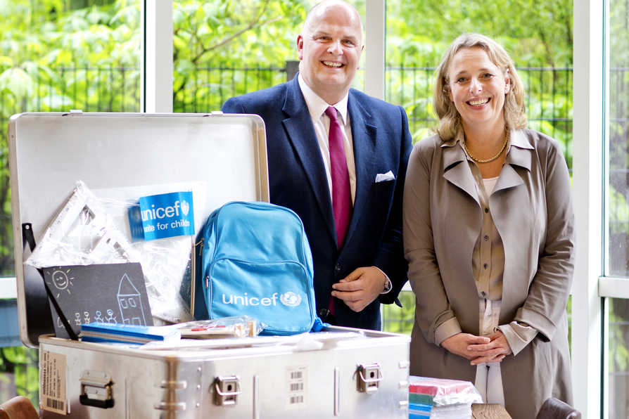 Thomas Ellerbeck and Suzanne Laszlo stand next to UNICEF's school-in-a-box